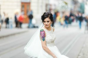tatooed bride on urban street