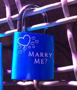 love lock on wall with marry me? engraved